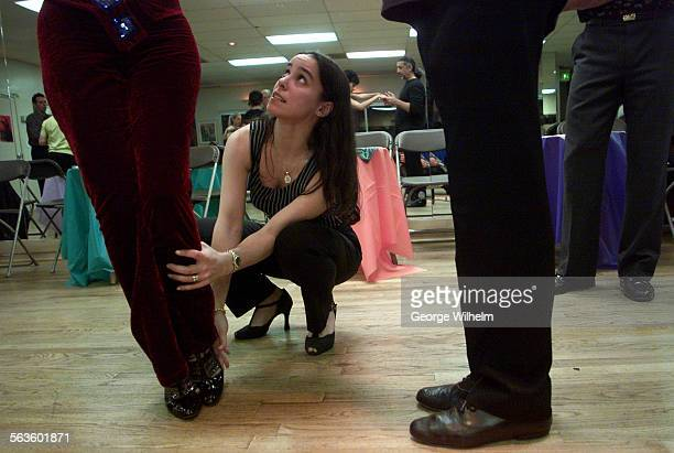 3/31/2001 – Dance instructor Barbara Thomas works on foot placement with a couple taking tango lessons at a Van Nuys studio Every Saturday night this...