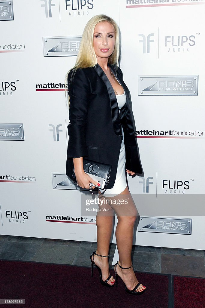 Dance music artist Irina arrives at the Matt Leinart Foundation's 7th Annual 'Celebrity Bowl' at Lucky Strikes on July 18, 2013 in Hollywood, California.