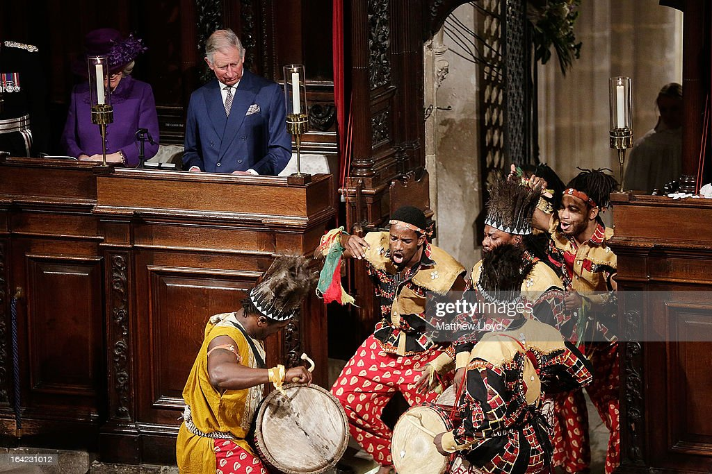 A dance troupe performs in front <a gi-track='captionPersonalityLinkClicked' href=/galleries/search?phrase=Prince+Charles&family=editorial&specificpeople=160180 ng-click='$event.stopPropagation()'>Prince Charles</a>, Prince of Wales and <a gi-track='captionPersonalityLinkClicked' href=/galleries/search?phrase=Camilla+-+Duchess+of+Cornwall&family=editorial&specificpeople=158157 ng-click='$event.stopPropagation()'>Camilla</a>, Duchess of Cornwall after The Most Rev Justin Welby was enthroned as Archbishop of Canterbury at Canterbury Cathedral on March 21, 2013 in Canterbury, England. The newly appointed Archbishop of Canterbury Justin Welby is enthroned today, installing him as the 105th Archbishop of Canterbury and head of the Church of England, in front of bishops and religious of the Anglican communion from around the world, the Prime Minister David Cameron, The Prince of Wales and other dignitaries.
