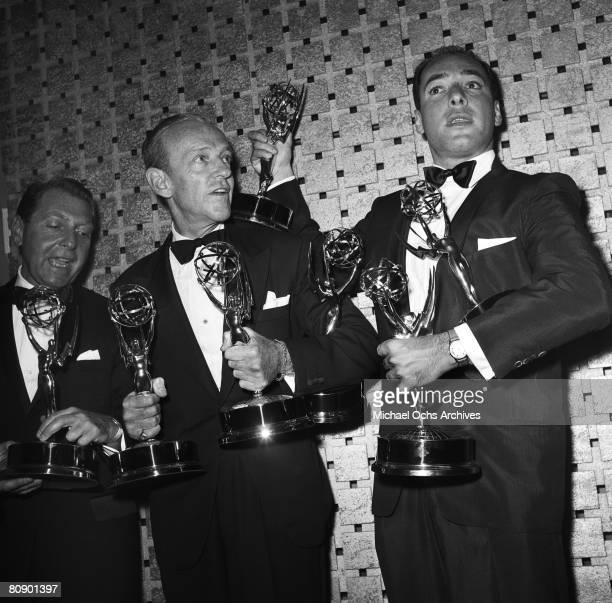 Dancer actor and singer Fred Astaire and writer/director Bud Yorkin and writer Herbert Baker pose for photos with all their awards for their TV...