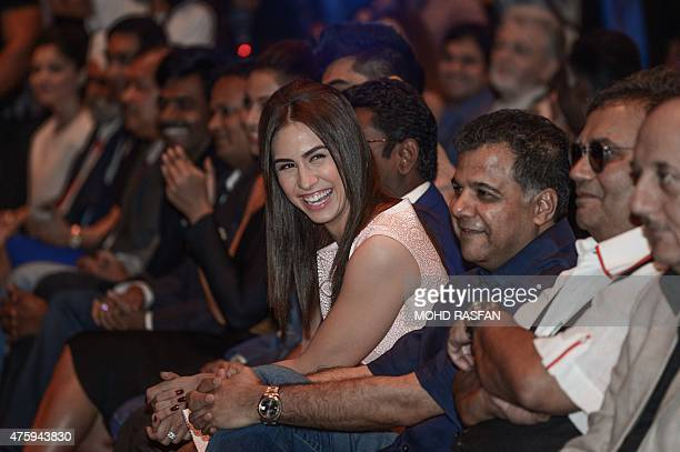 US dancer and actress Lauren Gottlieb smiles as she attends the IIFA weekend press conference on the first day of the 16th International Indian Film...