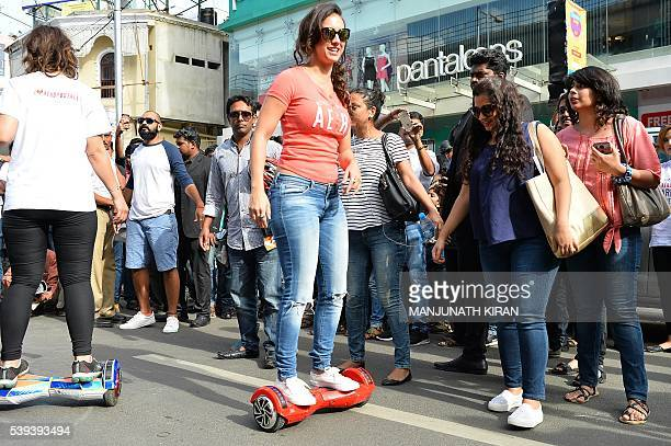 US dancer and Bollywood actress Lauren Gottlieb takes part in an event on a hover board in Bangalore on June 11 2016 Gottlieb's act was part of a...