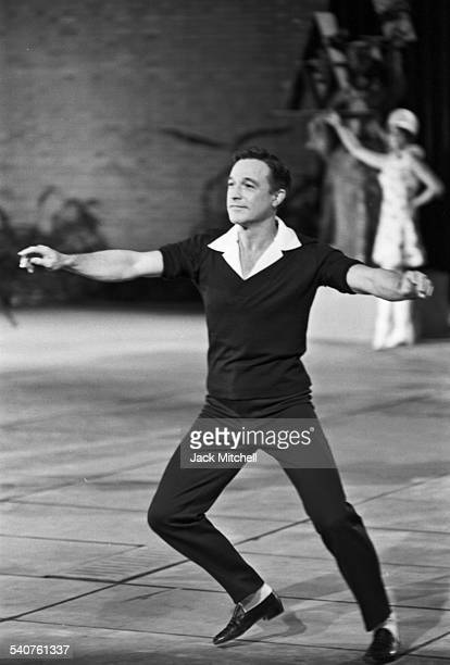 Dancer and choreographer Gene Kelly performing at night in the sculpture garden of the Museum of Modern Art for the CBS television special 'New York...