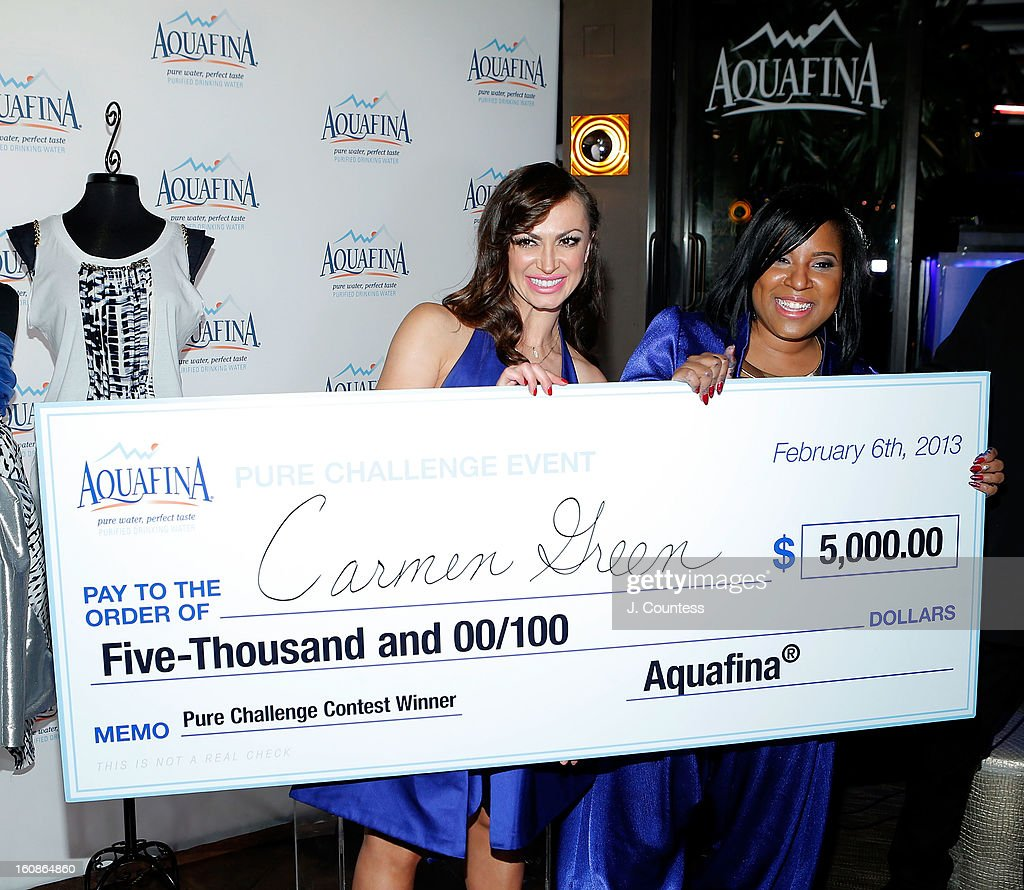 Dancer and host Karina Smirnoff and designer Carmen Green of Baltimore, MD pose for a photo after Carmen is declared the winner of the Aquafina 'Pure Challenge' at the Aquafina 'Pure Challenge' After Party at The Empire Hotel Rooftop on February 6, 2013 in New York City.