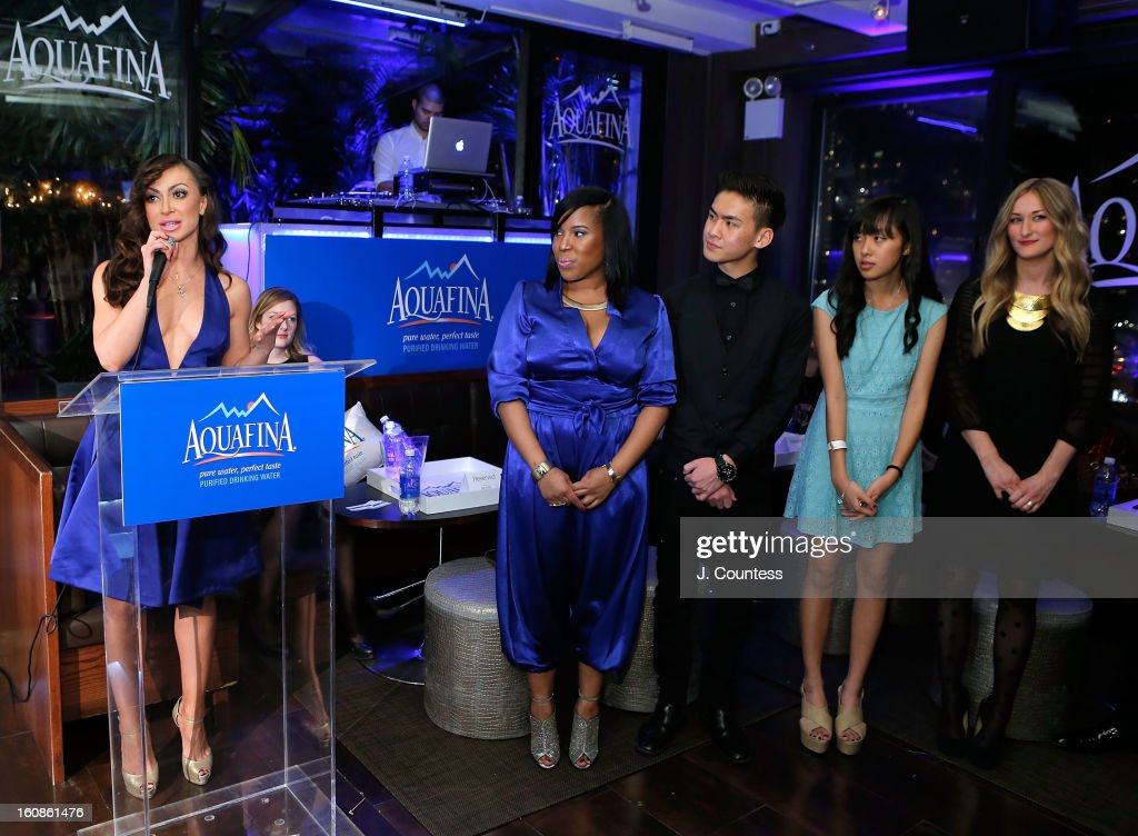 Dancer and host Karina Smirnoff introduces the competitors during the Aquafina 'Pure Challenge' at the Aquafina 'Pure Challenge' After Party at The Empire Hotel Rooftop on February 6, 2013 in New York City.