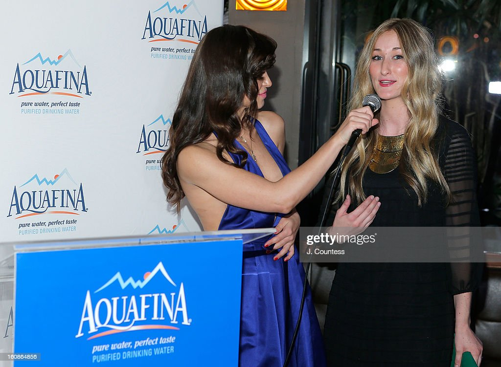 Dancer and host Karina Smirnoff speaks with designer Ashley Cooper during the Aquafina 'Pure Challenge' at the Aquafina 'Pure Challenge' After Party at The Empire Hotel Rooftop on February 6, 2013 in New York City.