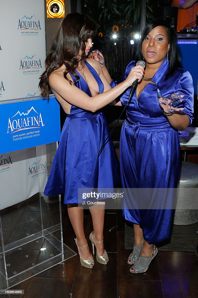 Dancer and host Karina Smirnoff speaks with designer Carmen Green during the Aquafina 'Pure Challenge' at the Aquafina 'Pure Challenge' After Party at The Empire Hotel Rooftop on February 6, 2013 in New York City.