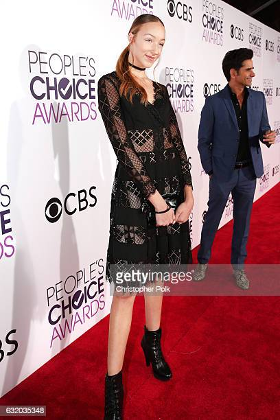 Dancer Ava Cota and actor John Stamos attend the People's Choice Awards 2017 at Microsoft Theater on January 18 2017 in Los Angeles California