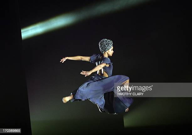 Dancer Belen Pereyra of the Alvin Ailey American Dance Theater performs part of 'Four Corners' during a dress rehearsal June 12 2013 as the Alvin...