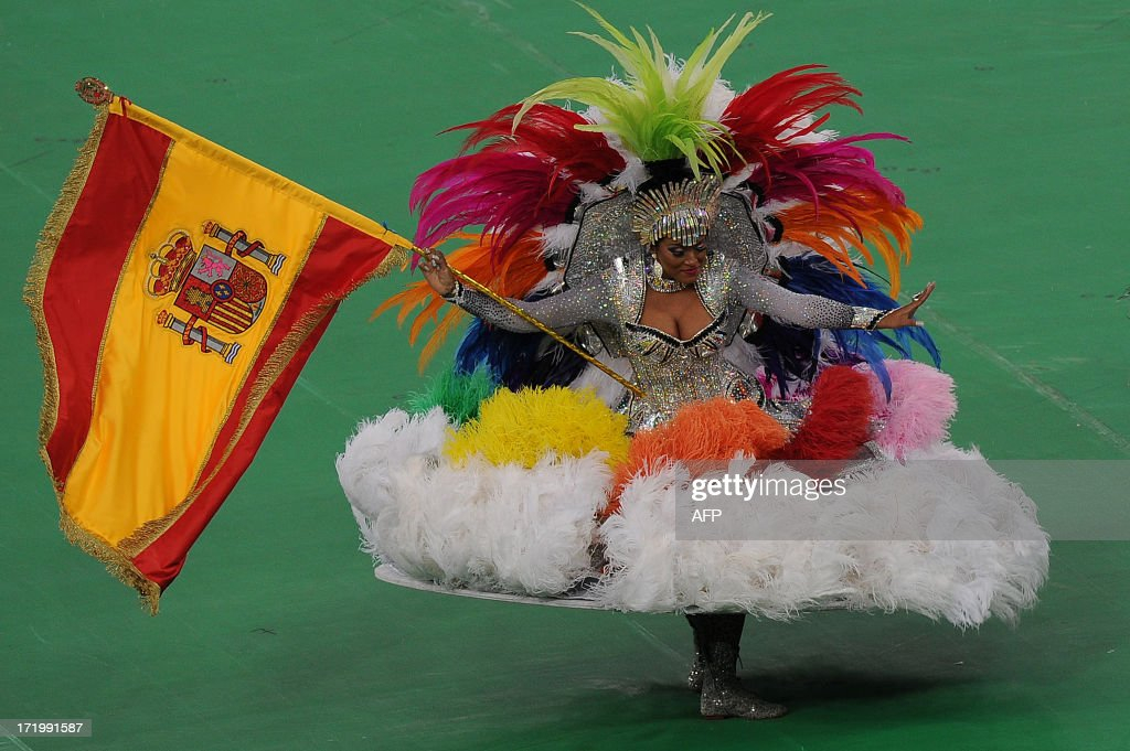 A dancer carrying the national flag of Spain perfoms during the closing ceremony of the FIFA Confederations Cup Brazil 2013 football tournament held before the final between Brazil and Spain, at the Maracana Stadium in Rio de Janeiro on June 30, 2013.
