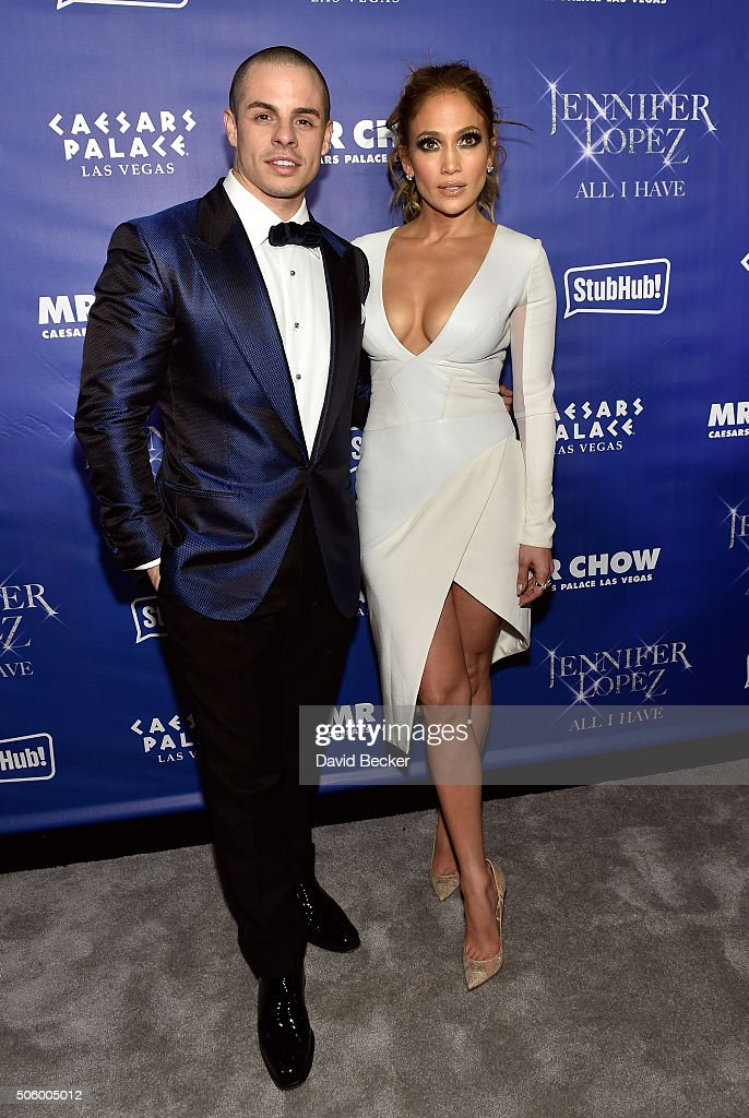 Dancer Casper Smart (L) and singer/actress Jennifer Lopez arrive at the after party for her residency 'JENNIFER