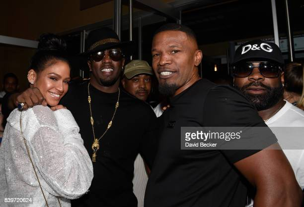Dancer Cassie recording artist Sean 'Puffy' Combs and actor Jamie Foxx arrive on TMobile's magenta carpet duirng the Showtime WME IME and Mayweather...