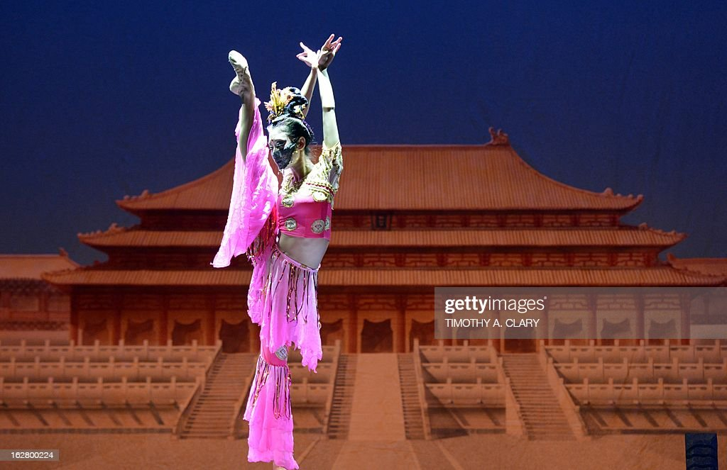 Dancer Chen Chen with the Gansu Dance Theatre performs a scene from 'Silk Road' at the dress rehearsal before opening night of their New York premiere at the David H. Koch Theater at Lincoln Center ON February 27, 2013. The production is presented by The China Arts & Entertainment Group (CAEG), a creative enterprise under the administration of the Ministry of Culture for the People's Republic of China. The show runs until March 3.