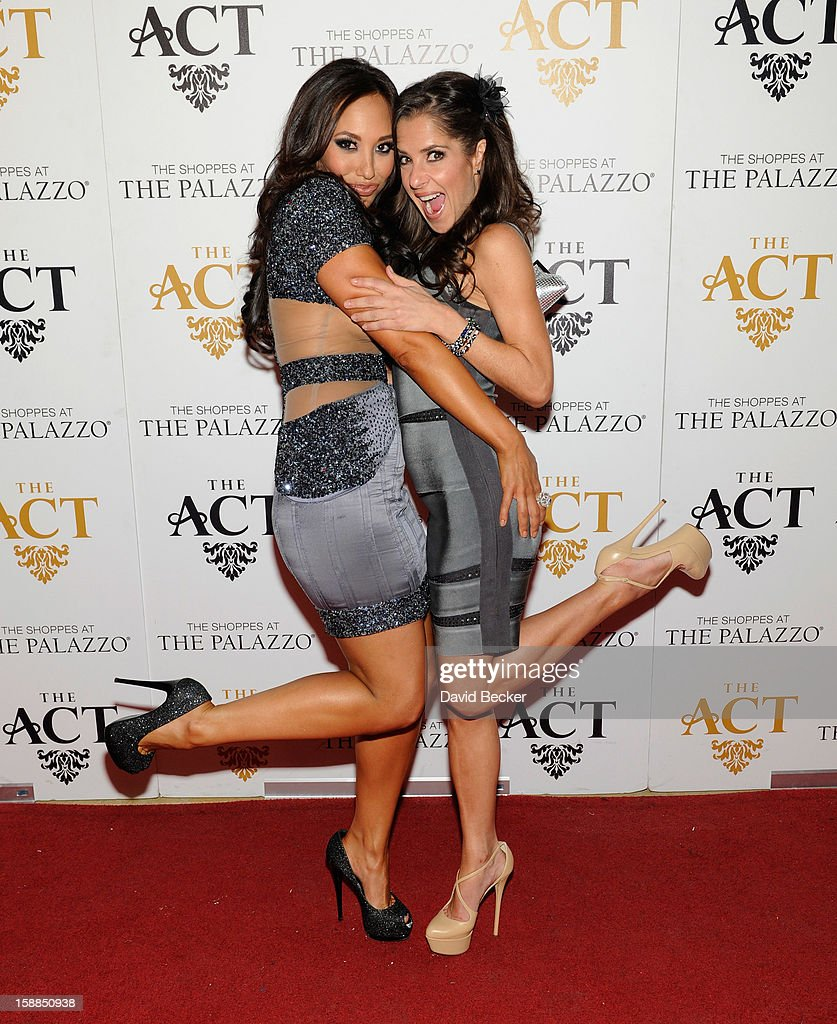 Dancer Cheryl Burke (L) and actress Kelly Monaco arrive at the New Year's Eve celebration at The Act at The Palazzo on December 31, 2012 in Las Vegas, Nevada.