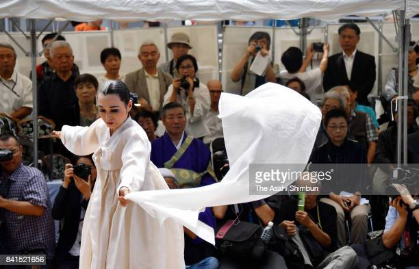 A dancer dedicates in front of the memorial for the Korean victims of the Great Kanto Earthquake at Yokoami Park on September 1 2017 in Tokyo Japan...