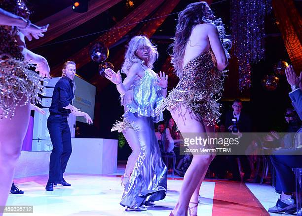 Dancer Derek Hough and host Goldie Hawn perform at Goldie Hawn's inaugural 'Love In For Kids' benefiting the Hawn Foundation's MindUp program...