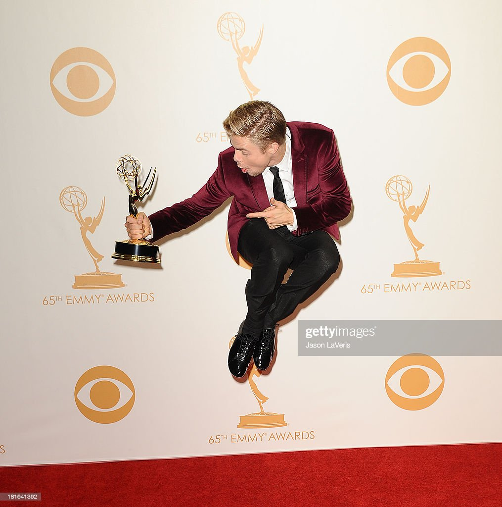 Dancer <a gi-track='captionPersonalityLinkClicked' href=/galleries/search?phrase=Derek+Hough&family=editorial&specificpeople=4532214 ng-click='$event.stopPropagation()'>Derek Hough</a> poses in the press room at the 65th annual Primetime Emmy Awards at Nokia Theatre L.A. Live on September 22, 2013 in Los Angeles, California.