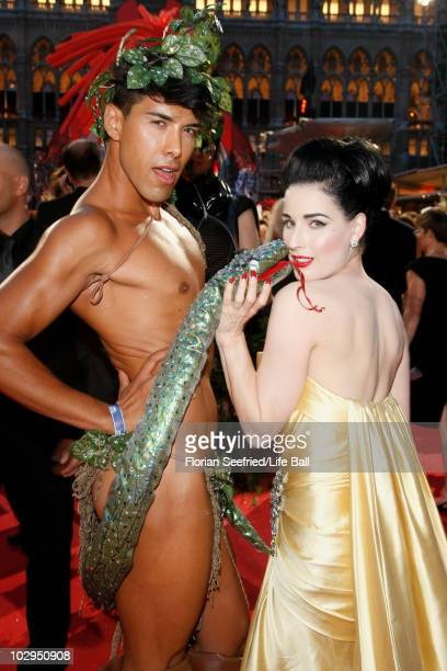 Dancer Dita von Teese poses with dancer Oscar Loya the 18th Life Ball at the Town Hall on July 17 2010 in Vienna Austria The Life Ball is an annual...