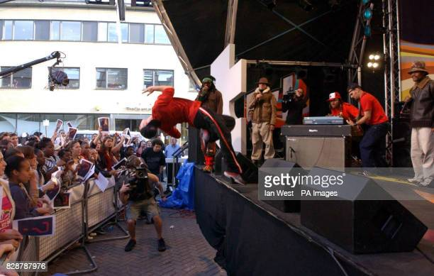 A dancer does a back flip off the stage during a live performance by American Hip Hop group The Black Eyed Peas on the MTV TRL UK show at the MTV...