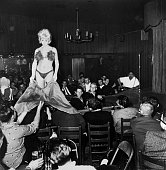 A dancer entertains men at Carousel Club the nightclub owned by Jack Ruby This photograph was part of the evidence in the John F Kennedy...