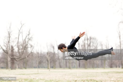 A dancer flies in the park : Stock Photo