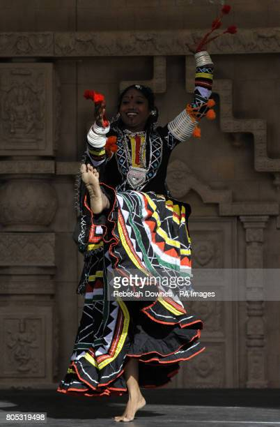 A dancer from Indian dance group Dhyanadhara performs live on stage wearing a tradional costume during the Village India Experience Gujarat held at...