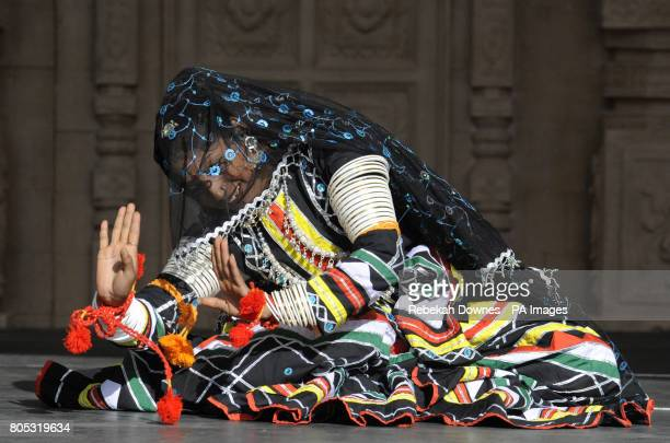A dancer from Indian dance group Dhyanadhara performs live on stage in a tradional costume during the Village India Experience Gujarat held at De...