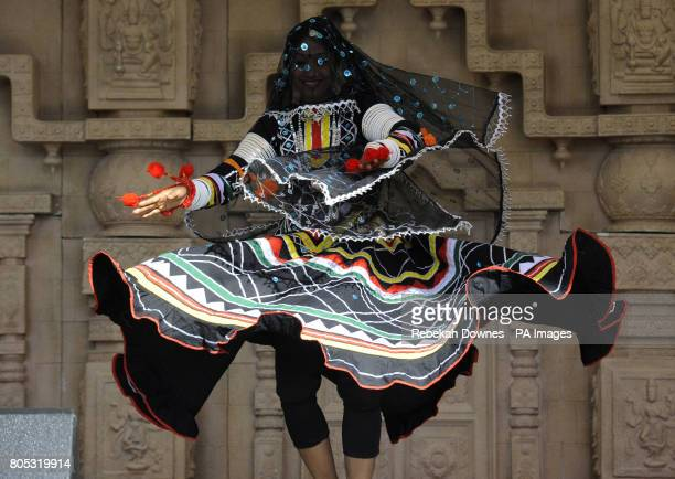A dancer from Indian dance group Dhyanadhara performs wearing a traditional costume live on stage during the Village India Experience Gujarat held at...