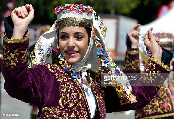 A dancer from Istanbul region wears a traditional costume during a performance ahead of the opening stage of the 52nd Presidential Tour of Turkey...