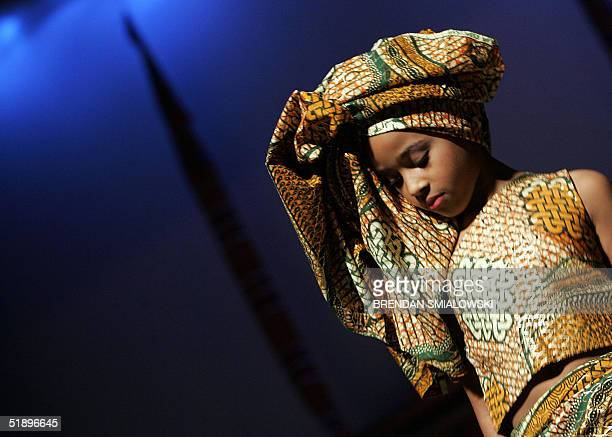 A dancer from the Ethiopian Ambassador's Children's Group waits to perform during a Kwanzaa celebration 26 December 2004 at the Lincoln Theater in...