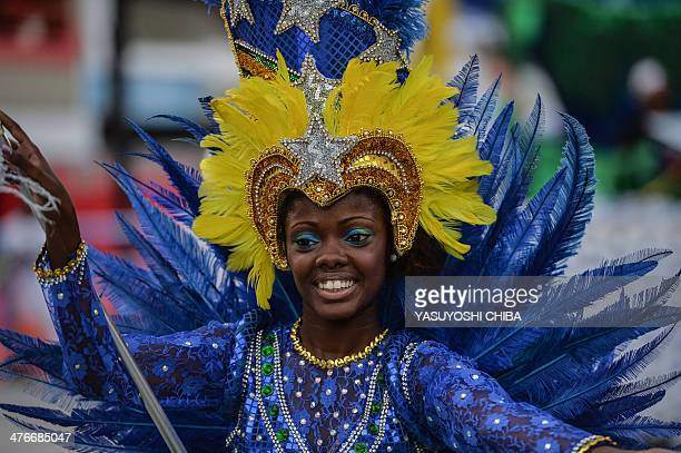 A dancer from the Filhos da Aguia junior samba school performs during the juniro carnival parade at the Sambadrome in Rio de Janeiro Brazil on March...