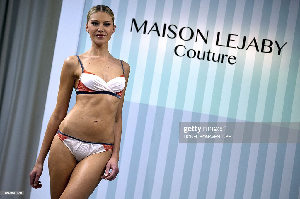 A dancer from the French cabaret Le 'Lido' displays a creation designed by French lingerie company Lejaby, during the women's Fall-Winter 2013-2014 collection show on January 17, 2013 in Paris. AFP PHOTO / LIONEL BONAVENTURE