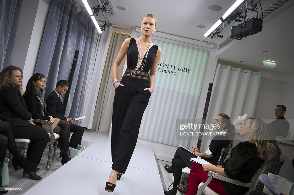 A dancer from the French cabaret Le 'Lido' displays a creation designed by French lingerie company Lejaby, during the women's Fall-Winter 2013-2014 collection show on January 17, 2013 in Paris.