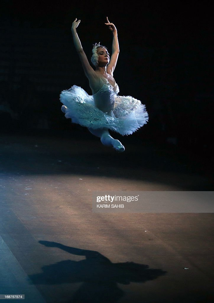 A dancer from the Moscow Royal Ballet, accompanied by Royal Moscow Orchestra, performs Pyotr Ilyich Tchaikovsky's 'Swan Lake' at a theater in the World Trade Center in Dubai, on May 14, 2012, on the last evening of four performance.