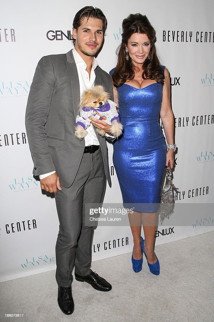Dancer Gleb Savchenko (L) and TV personality Lisa Vanderpump arrive at the Genlux new issue launch party hosted by Lisa Vanderpump on November 14, 2013 in Beverly Hills, California.