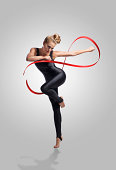 Dancer holding a ribbon making the infinity symbol