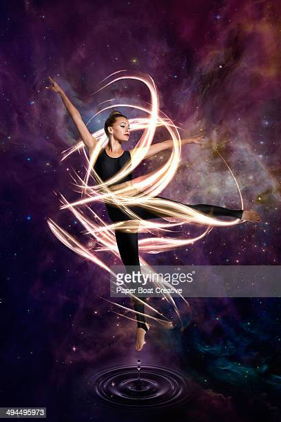 Dancer in electric waves around her in cosmic sky