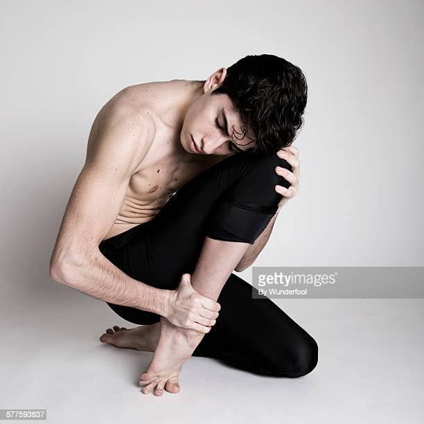 Dancer in tights sitting on the floor