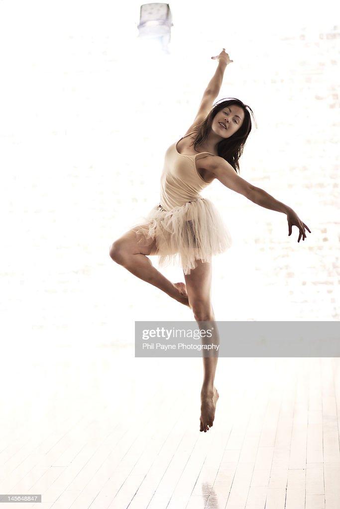 Dancer in white tutu leaps in air
