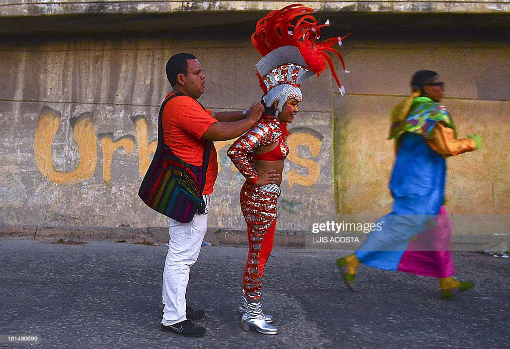 A dancer is seen after taking part in the third day of carnival in Barranquilla, Colombia, on February 11, 2013. Barranquilla's Carnival, a tradition created by locals at the end of the 19th century as a response and to parody the celebration held by European immigrants and aristocracy, was declared a 'Masterpiece of Oral and Intangible Heritage of Humanity' by the UNESCO in 2003. AFP PHOTO/Luis Acosta