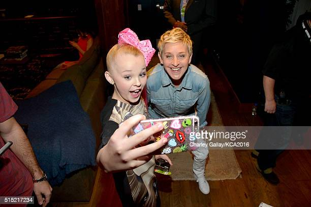 Dancer JoJo Siwa and TV personality Ellen DeGeneres take a selfie during Nickelodeon's 2016 Kids' Choice Awards at The Forum on March 12 2016 in...