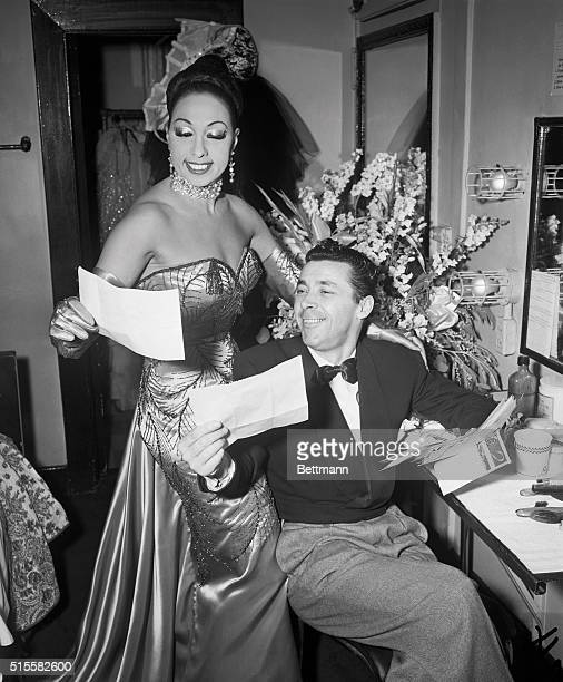 Dancer Josephine Baker and her French husband Joe Bouillion read congratulatory letters in her dressing room at Manhattan's Strand Theater after she...