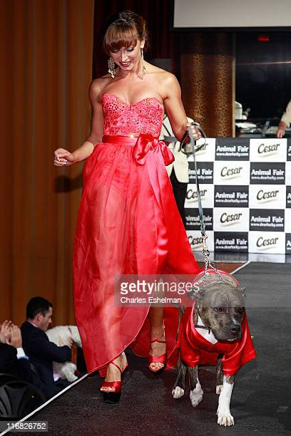 Dancer Karina Smironoff and her dog Randy attend Animal Fair's 10th Annual Paws For Style at M2 Ultra Lounge on July 27 2009 in New York City