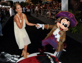 Dancer Lacey Schwimmer and Mickey Mouse arrive at premiere of Walt Disney Pictures' 'Pirates of the Caribbean On Stranger Tides' held at Disneyland...