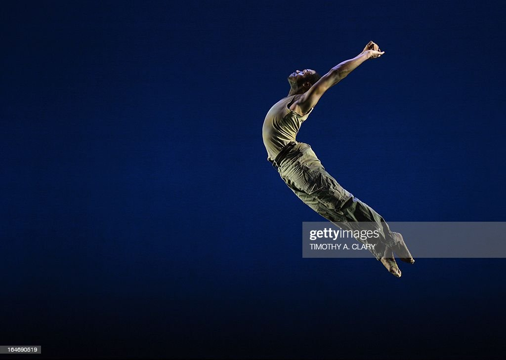 Dancer LaMichael Leonard, Jr. with the The Bill T. Jones/Arnie Zane Dance Company performs a scene from 'D-Man in the Waters' during a dress rehearsal before opening night at the Joyce Theatre March 26, 2013. The Bill T. Jones/Arnie Zane Dance Company commemorates thirty years of creativity and impact with a two-week engagement.
