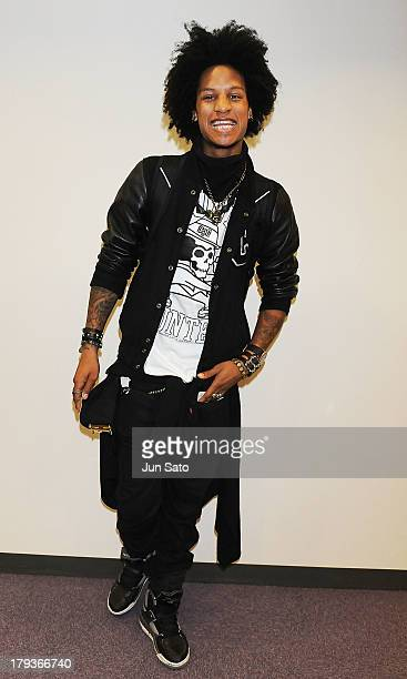 Dancer Larry Bourgeois of Les Twins poses for a photograph upon airport arrival on September 2 2013 in Tokyo Japan