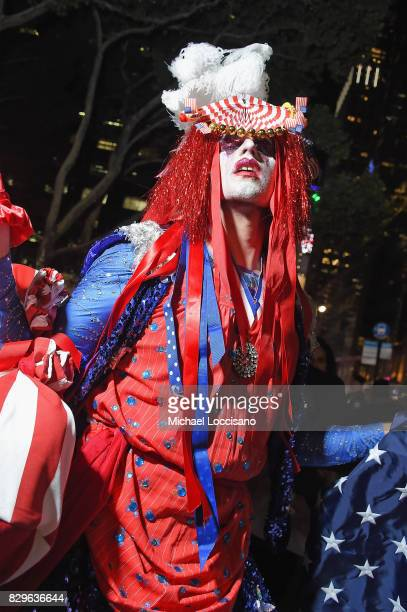 A dancer leads a procession through the streets to the after party as awardwinning filmmaker Michael Moore celebrates his Broadway Opening Night in...