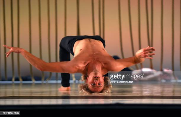 Dancer Leo Kirjonen with the Finnishbased dance troupe Tero Saarinen Company performs a scene from 'Morphed' during a dress rehearsal before opening...