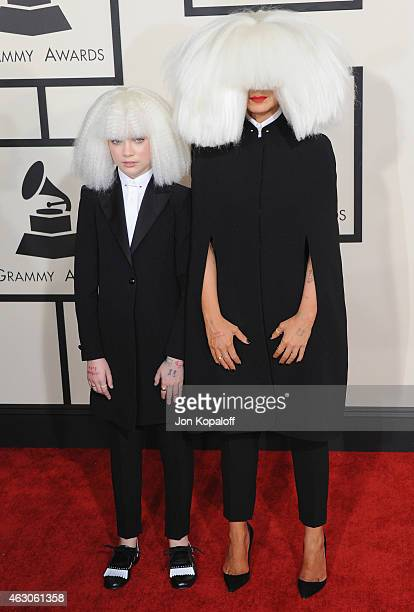 Dancer Maddie Ziegler and singer Sia arrive at the 57th GRAMMY Awards at Staples Center on February 8 2015 in Los Angeles California