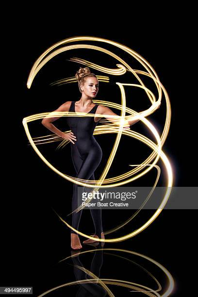 Dancer making beautiful yellow light rays